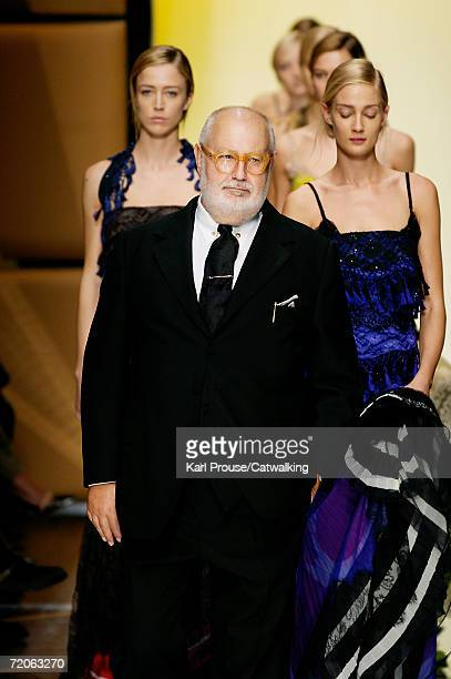 Designer Gianfranco Ferre walks down the catwalk with models during the Gianfranco Ferre Fashion Show as part of Milan Fashion Week Spring/Summer...