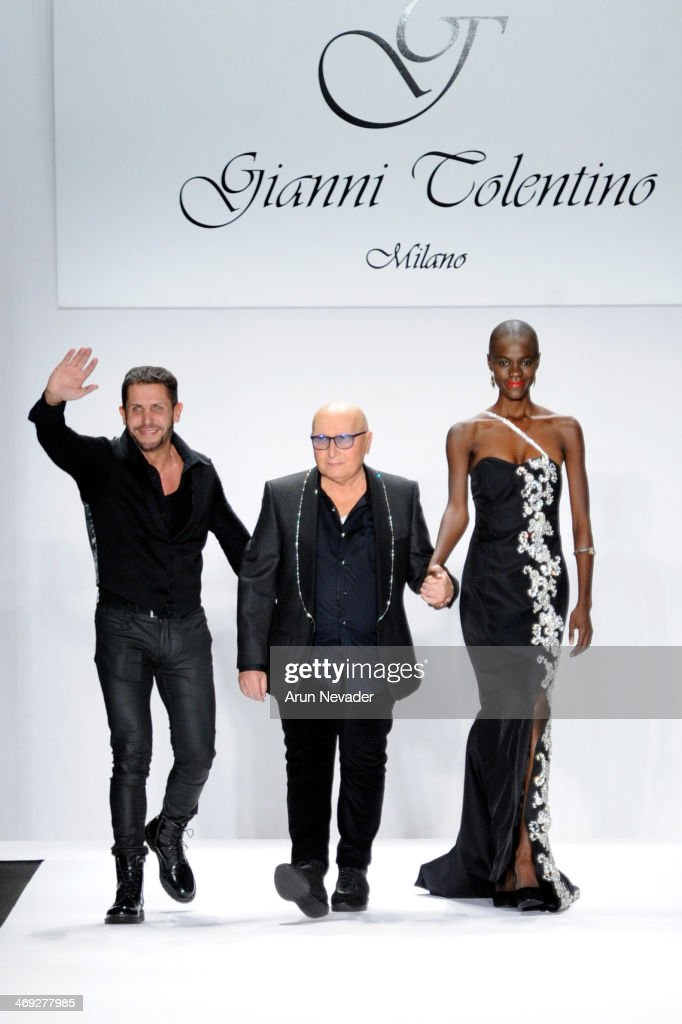Designer Gianni Tolentino walks the runway at the FLT Moda + Art Hearts Fashion show presented by AIDS Healthcare Foundation during Mercedes-Benz Fashion Week Fall 2014 at The Theatre at Lincoln Center on February 13, 2014 in New York City.
