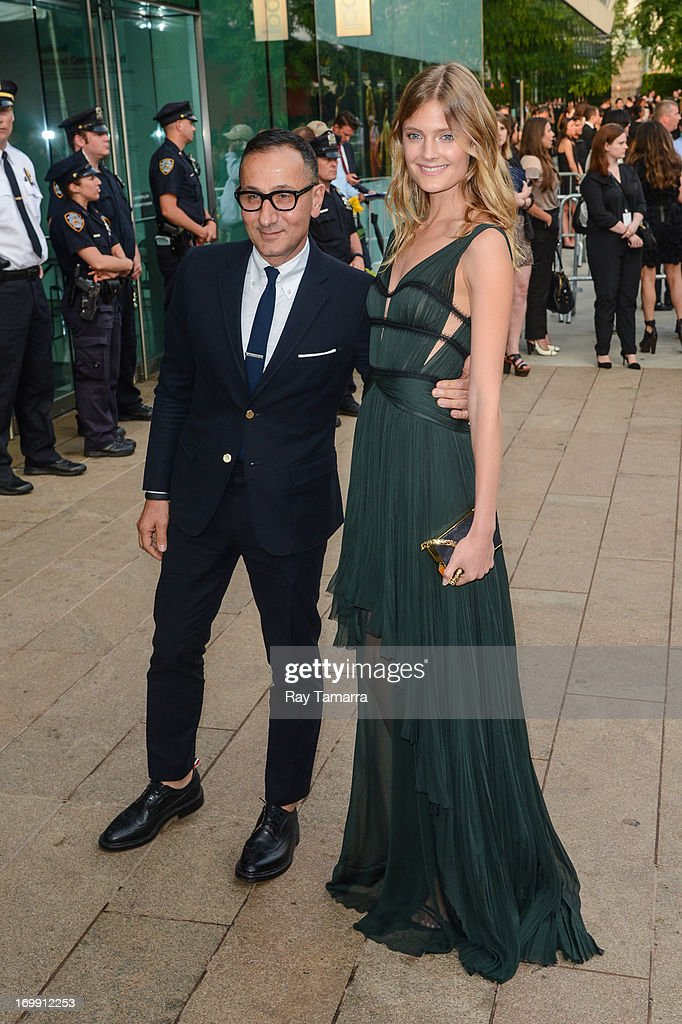Designer Gilles Mendel (L) and model Constance Jablonski enter the 2013 CFDA Fashion Awards on June 3, 2013 in New York, United States.