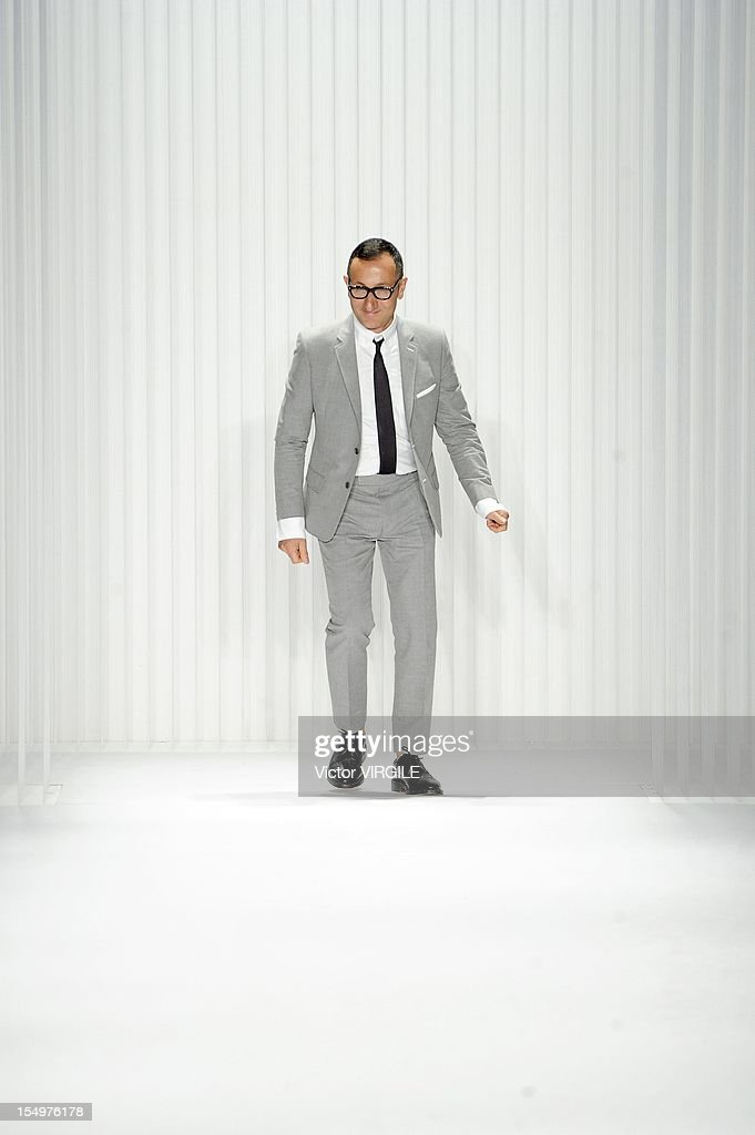 Designer <a gi-track='captionPersonalityLinkClicked' href=/galleries/search?phrase=Gilles+Mendel&family=editorial&specificpeople=638035 ng-click='$event.stopPropagation()'>Gilles Mendel</a> walks the runway at the J. Mendel Spring Summer 2013 fashion show during New York Fashion Week at The Theatre Lincoln Center on September 12, 2012 in New York, United States.