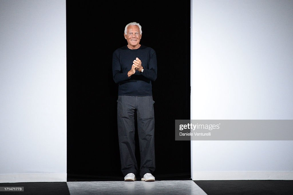 Designer Giorgio Armani acknowledges the applause of the audience after the Giorgio Armani show during Milan Menswear Fashion Week Spring Summer 2014 on June 25, 2013 in Milan, Italy.