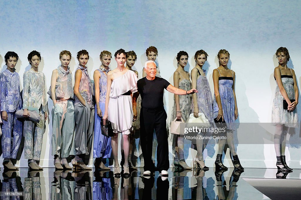 Designer Giorgio Armani acknowledges the applause of the audience after Emporio Armani show as a part of Milan Fashion Week Womenswear Spring/Summer 2014 on September 20, 2013 in Milan, Italy.