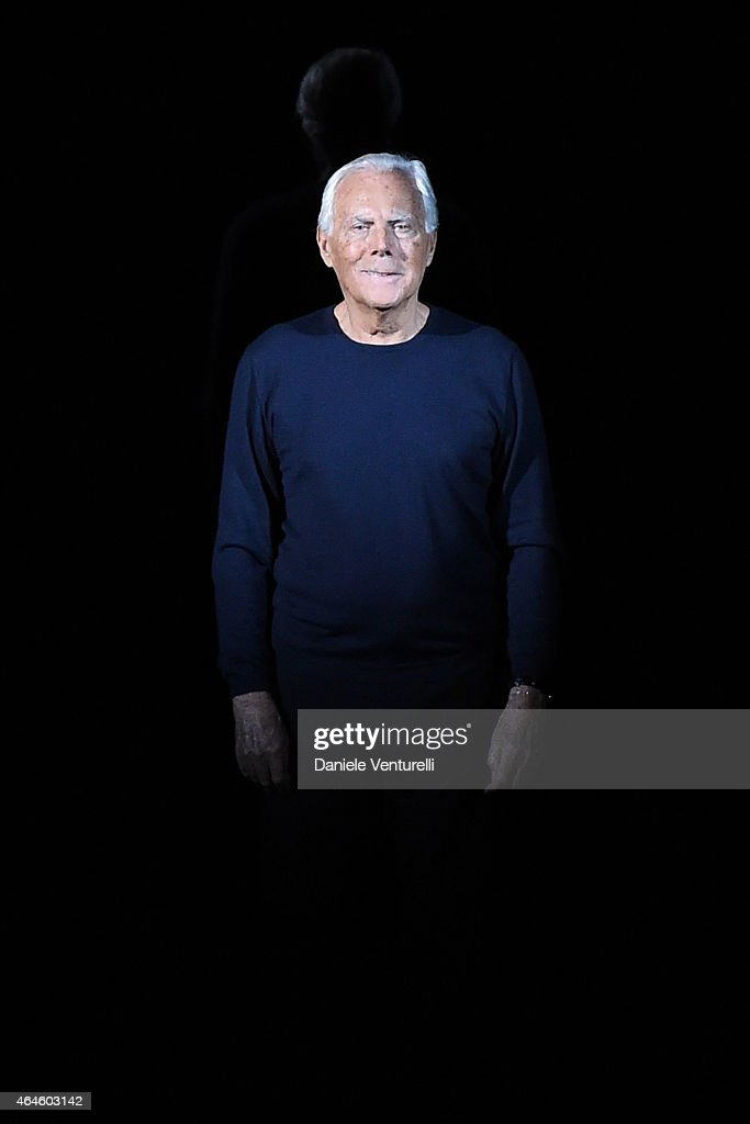 Designer Giorgio Armani acknowledges the applause of the audience after the Emporio Armani show during the Milan Fashion Week Autumn/Winter 2015 on...