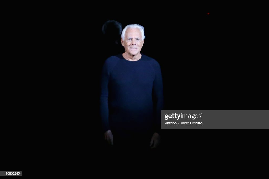 Designer <a gi-track='captionPersonalityLinkClicked' href=/galleries/search?phrase=Giorgio+Armani&family=editorial&specificpeople=4155761 ng-click='$event.stopPropagation()'>Giorgio Armani</a> acknowledges the applause of the audience during the Emporio Armani show as part of Milan Fashion Week Womenswear Autumn/Winter 2014 on February 21, 2014 in Milan, Italy.