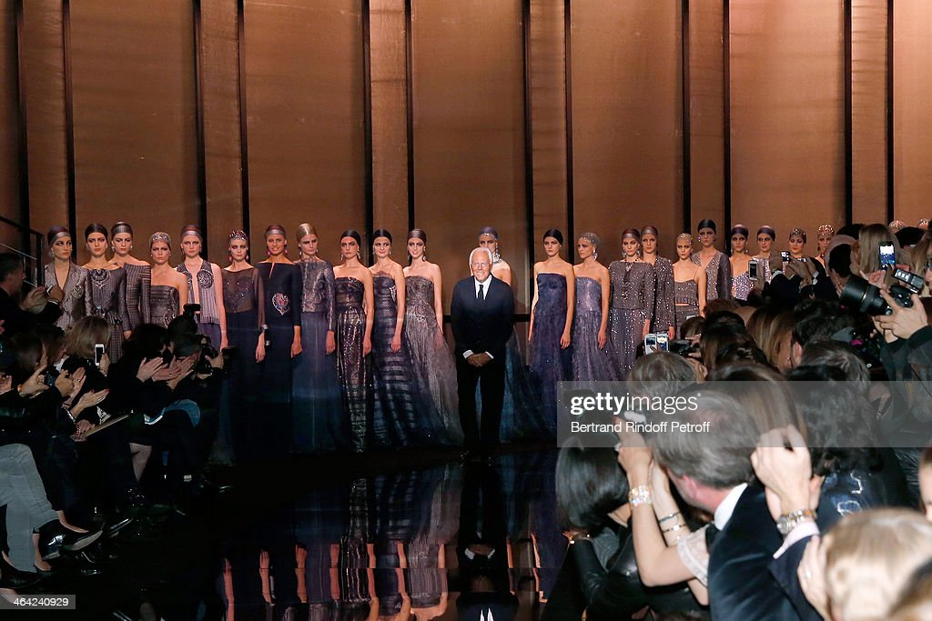 Designer <a gi-track='captionPersonalityLinkClicked' href=/galleries/search?phrase=Giorgio+Armani&family=editorial&specificpeople=4155761 ng-click='$event.stopPropagation()'>Giorgio Armani</a> acknowledges the applause of the public after his show <a gi-track='captionPersonalityLinkClicked' href=/galleries/search?phrase=Giorgio+Armani&family=editorial&specificpeople=4155761 ng-click='$event.stopPropagation()'>Giorgio Armani</a> Prive as part of Paris Fashion Week Haute Couture Spring/Summer 2014 on January 21, 2014 in Paris, France.
