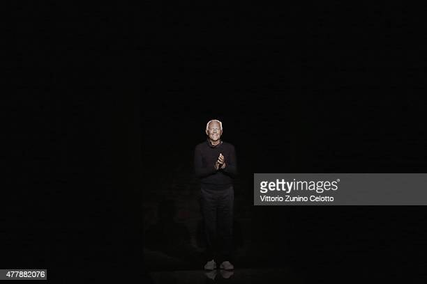Designer Giorgio Armani acknowledges the applause of the public after the Emporio Armani show as part of Milan Men's Fashion Week Spring/Summer 2016...