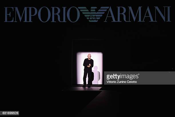 Designer Giorgio Armani acknowledges the applause of the public after the Emporio Armani show during Milan Men's Fashion Week Fall/Winter 2017/18 on...