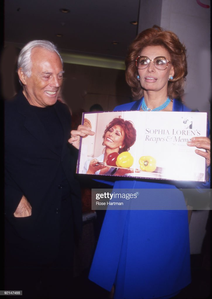 Designer Giorgio Armani and actress <a gi-track='captionPersonalityLinkClicked' href=/galleries/search?phrase=Sophia+Loren&family=editorial&specificpeople=94097 ng-click='$event.stopPropagation()'>Sophia Loren</a> at Loren's book party held at the Armani boutique in New York, 1999.