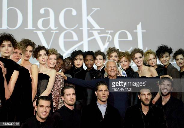 Designer Giorgio Armani poses with models at the end of his show 'Black Velvet' as part of the Women Autumn / Winter 2016 Milan Fashion Week on...