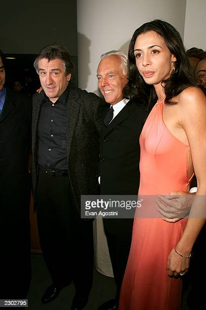 Designer Giorgio Armani with actor Robert DeNiro and his daughter Drena at the Armani Fashion retrospective opening night gala at the Guggenheim...