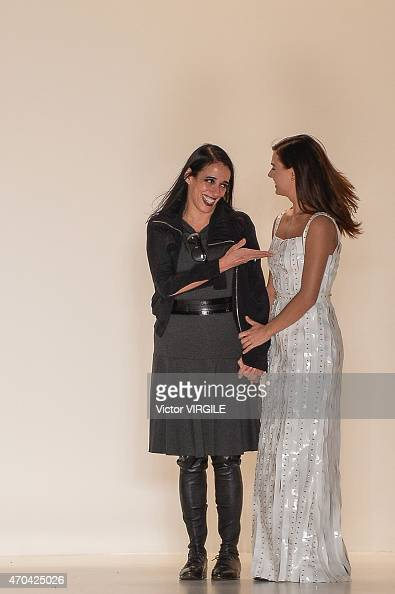 Designer Gloria Coelho and actress Isis Valverde walk the runway at the Gloria Coelho show during the SPFW Summer 2016 at Parque Candido Portinari on...