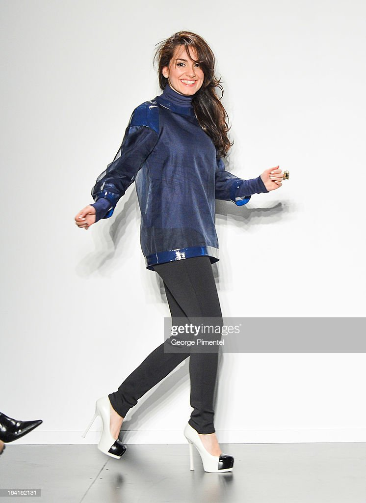 Designer <a gi-track='captionPersonalityLinkClicked' href=/galleries/search?phrase=Golnaz+Ashtiani&family=editorial&specificpeople=8557218 ng-click='$event.stopPropagation()'>Golnaz Ashtiani</a> presents her fall 2013 collection during World MasterCard Fashion Week Fall 2013 at David Pecaut Square on March 20, 2013 in Toronto, Canada.