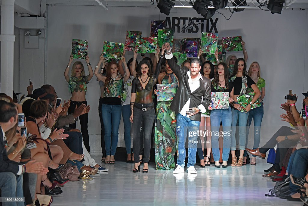 Designer Greg Polessini waves to the audience at the Artistix By Greg Polessini show during Spring 2016 New York Fashion Week: The Shows at The Designer's Loft on September 14, 2015 in New York City.