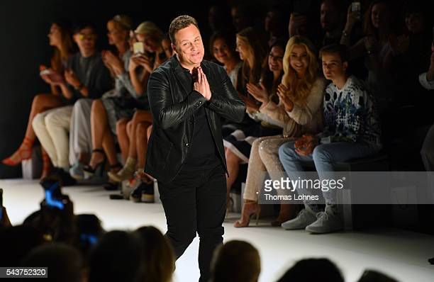 Designer Guido Maria Kretschmer acknowledges the applause of the audience after his show during the MercedesBenz Fashion Week Berlin Spring/Summer...