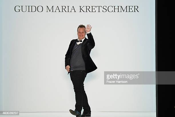Designer Guido Maria Kretschmer acknowledges the audience after the Guido Maria Kretschmer Show during MercedesBenz Fashion Week Autumn/Winter...