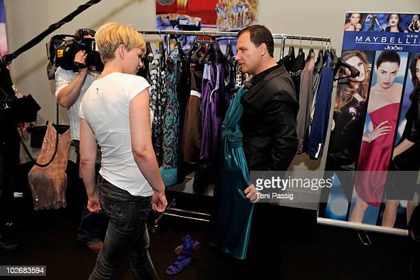 Designer Guido Maria Kretschmer and Karen Heinrichs are seen backstage at the Guido Maria Kretschmer Show during the Mercedes Benz Fashion Week...