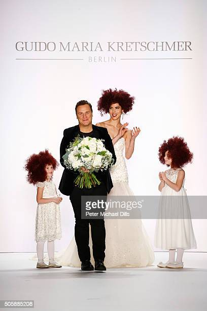 Designer Guido Maria Kretschmer and model Zoe Helali walk the runway at the Guido Maria Kretschmer show during the MercedesBenz Fashion Week Berlin...