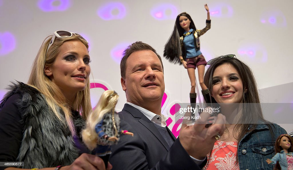 Designer Guido Maria Kretschmer and models pose with the Barbie Collection 2014 during a Barbie Runwayshow at the Press-Preview of the Nuremberg International Toy Fair 2014 on January 28, 2014 in Nuremberg, Germany. The Nuremberg International Toy Fair 2014 is the worlds biggest toy fair and is opendend to visitors from January 29th to February 3rd.