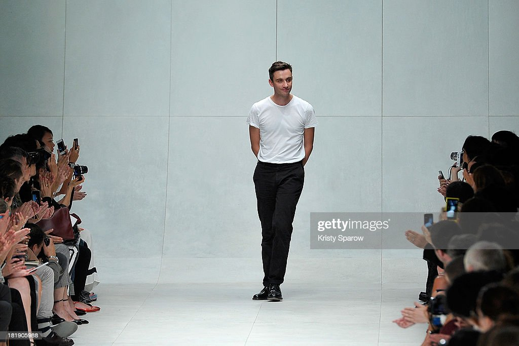Designer Guillaume Henry acknowledges the audience during the Carven show as part of Paris Fashion Week Womenswear Spring/Summer 2014 on September 26, 2013 in Paris, France.