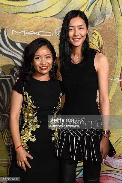 Designer Guo Pei and model Liu Wen attend the MAC x Guo Pei dinner on May 5 2015 in New York City