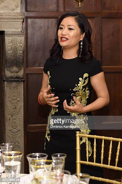 Designer Guo Pei speaks to guests at the MAC x Guo Pei dinner on May 5 2015 in New York City