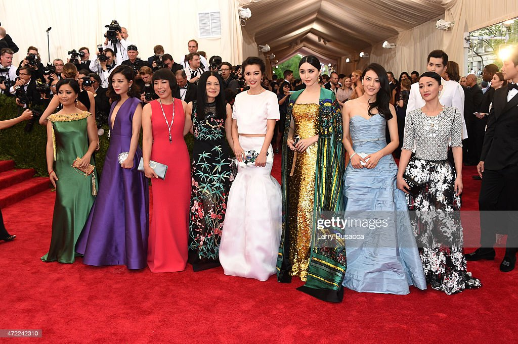 Designer GuoPei, Vicky Zhao, <a gi-track='captionPersonalityLinkClicked' href=/galleries/search?phrase=Zhang+Yu&family=editorial&specificpeople=559070 ng-click='$event.stopPropagation()'>Zhang Yu</a>, guest, bing bing Li, guest, <a gi-track='captionPersonalityLinkClicked' href=/galleries/search?phrase=Yuanyuan+Gao&family=editorial&specificpeople=220875 ng-click='$event.stopPropagation()'>Yuanyuan Gao</a>, and Xun Zhou attends the 'China: Through The Looking Glass' Costume Institute Benefit Gala at the Metropolitan Museum of Art on May 4, 2015 in New York City.