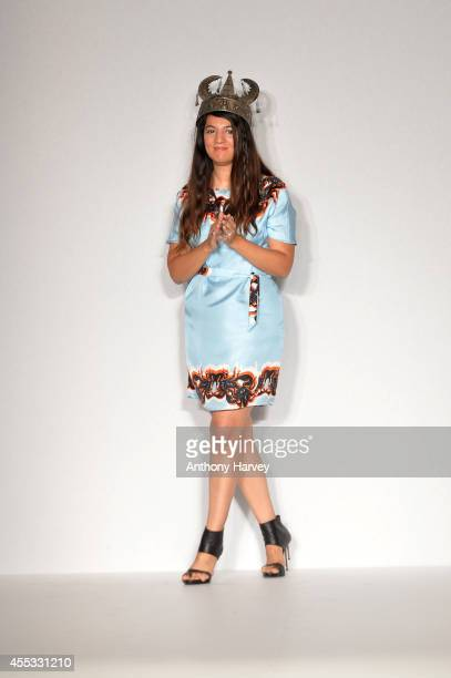 Designer Gyunel Rustamova appears at the end of the runway at the Gyunel show during London Fashion Week Spring Summer 2015 at Bloomsbury Ballroom on...