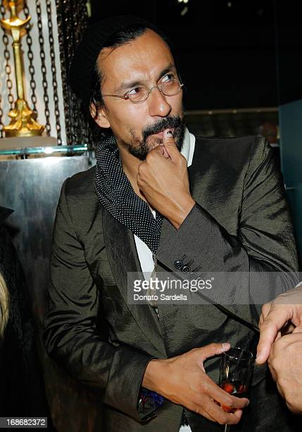 Designer Haider Ackermann attends Saks Fifth Avenue Honors Haider Ackermann at Mr Chow on May 9 2013 in Beverly Hills California