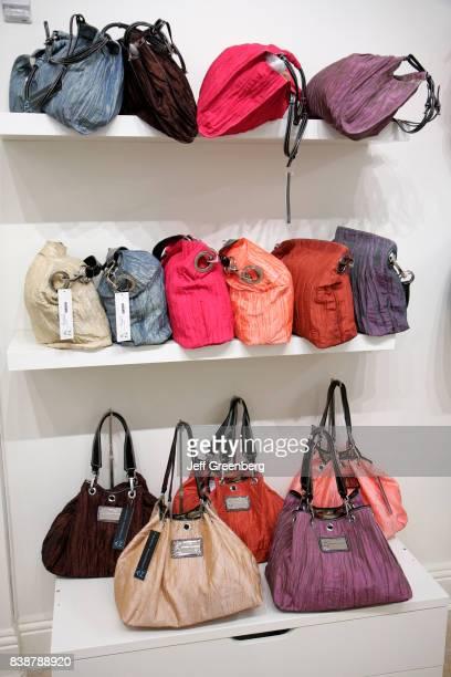 Designer handbags on display in a store on Washington Avenue