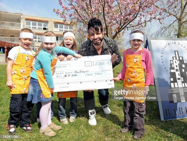 Designer Harald Gloeoeckler hands over a 5000 euro cheque to the 'Deutsches Kinderhilfswerk' in a Kindergarden in BerlinHellersdorf on April 16 2012...