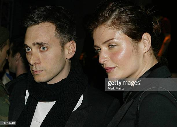 Designer Hedi Slimane and model Helena Christiensen attend the Dior Homme Concert and Party in honor of the Dior Homme Store Opening on March 10th...