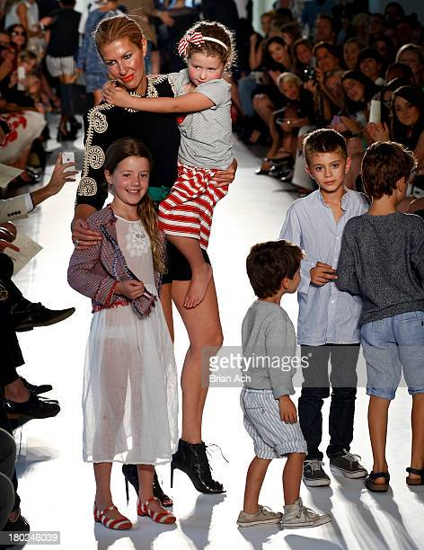 Designer Heidi Middleton appears on the runway at the Sass Bide fashion show during MercedesBenz Fashion Week Spring 2014 at The Classic Car Club on...
