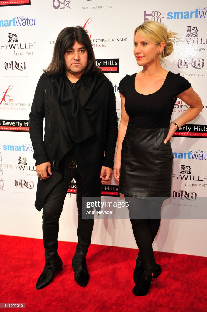 Designer Henry Duarte appears on the red carpet with actor and muse Kristine Miller at 'Meet The Designer and the Muse' at Ace Gallery on March 8, 2012 in Los Angeles, California.
