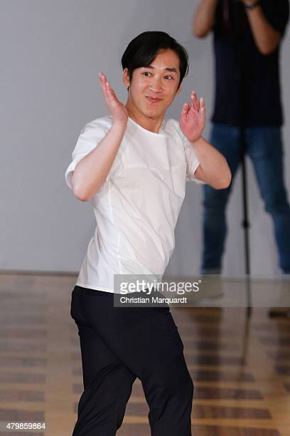 Designer Hien Le walks the runway after his show during the MercedesBenz Fashion Week Berlin Spring/Summer 2016 at Kronprinzenpalais on July 8 2015...
