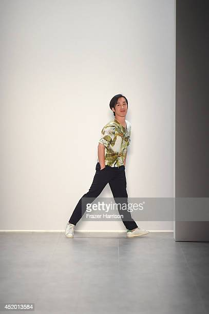 Designer Hien Le walks the runway at the Hien Le show during the MercedesBenz Fashion Week Spring/Summer 2015 at Erika Hess Eisstadion on July 11...