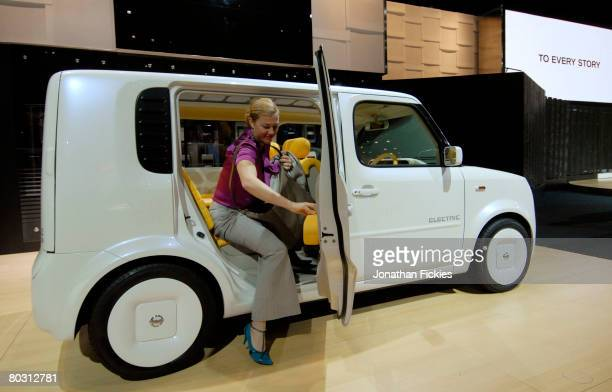 Designer Hilary Read checks out the interior of the Nissan Denki Cube concept vehicle at the New York International Auto Show March 19 2008 in New...