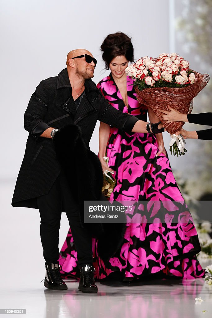 Designer Igor Gulyaev (L) celebrates the finale of the IGOR GULYAEV show during Mercedes-Benz Fashion Week Russia S/S 2014 on October 26, 2013 in Moscow, Russia.