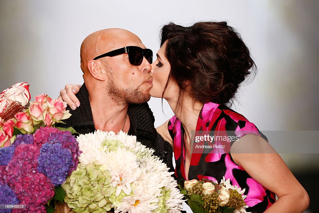 Designer Igor Gulyaev kisses a model on the runway of the IGOR GULYAEV show during Mercedes-Benz Fashion Week Russia S/S 2014 on October 26, 2013 in Moscow, Russia.