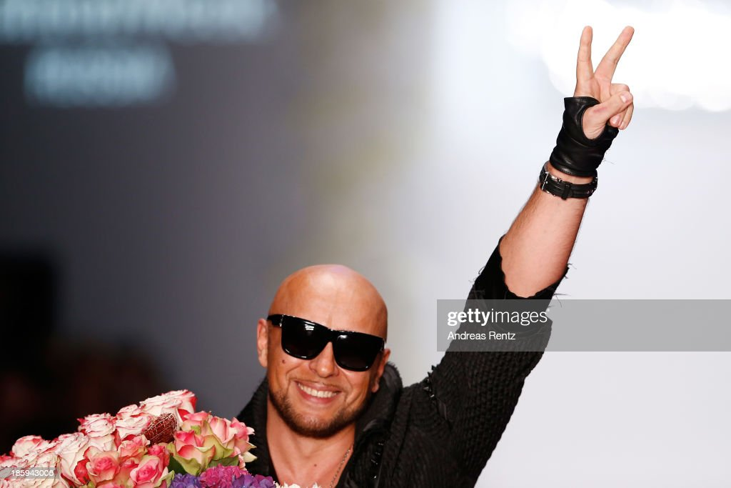 Designer Igor Gulyaev salutes the crowd at the finale of the IGOR GULYAEV show during Mercedes-Benz Fashion Week Russia S/S 2014 on October 26, 2013 in Moscow, Russia.