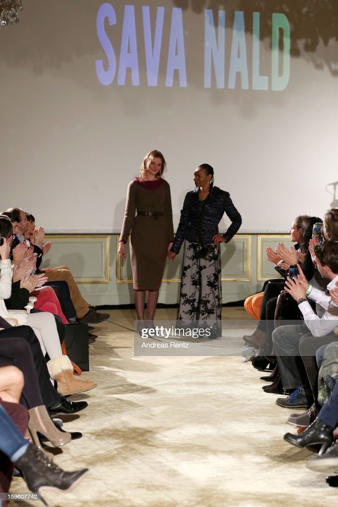 Designer Inna Thomas and Valerie Campbell walk the runway at Sava Nald Autumn/Winter 2013/14 fashion show during Mercedes-Benz Fashion Week Berlin at Hotel Adlon Kempinski on January 17, 2013 in Berlin, Germany.