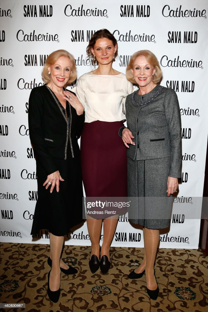 Designer Inna Thomas poses with Alice and Ellen Kessler at the Sava Nald show during the Mercedes-Benz Fashion Week Autumn/Winter 2014/15 at Hotel Adlon on January 14, 2014 in Berlin, Germany.