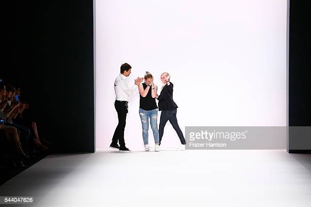 Designer Irene Luft acknowledges the applause of the audience at the Irene Luft show during the MercedesBenz Fashion Week Berlin Spring/Summer 2017...