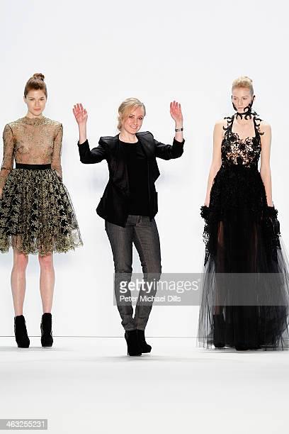 Designer Irene Luft acknowledges the audience after the Irene Luft show during MercedesBenz Fashion Week Autumn/Winter 2014/15 at Brandenburg Gate on...