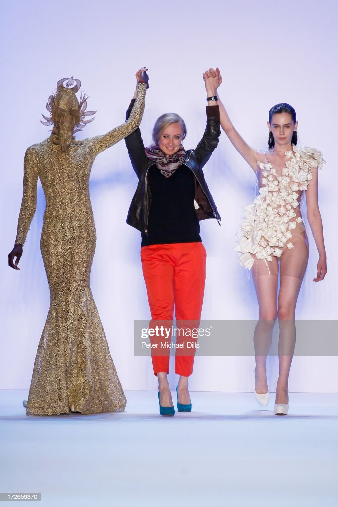 Designer Irene Luft (C) and two of her models at the end of the Irene Luft Show during the Mercedes-Benz Fashion Week Spring/Summer 2014 at Brandenburg Gate on July 4, 2013 in Berlin, Germany.