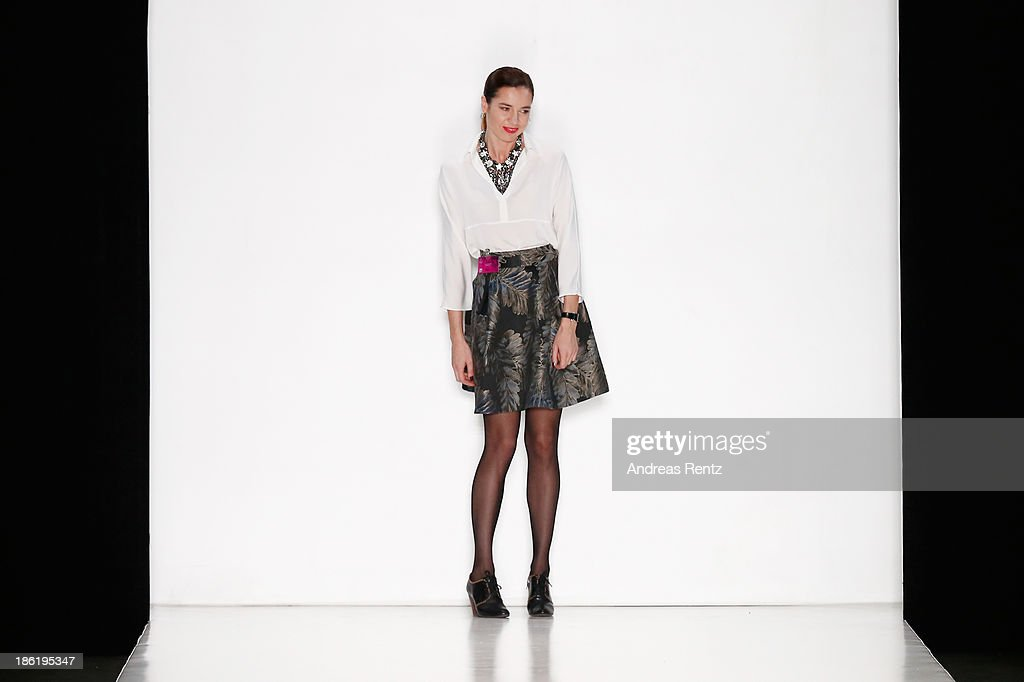 Designer Irina Boitsik appears on the runway at the Belarus Fashion Week Collective Show during Mercedes-Benz Fashion Week Russia S/S 2014 on October 29, 2013 in Moscow, Russia.