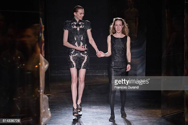 Designer Iris Van Herpen and a model walk the runway during the Iris Van Herpen show as part of the Paris Fashion Week Womenswear Fall/Winter...