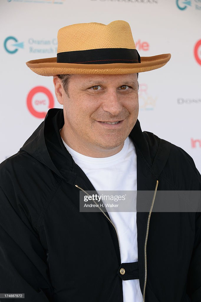 Designer Isaac Mizrahi attends the Ovarian Cancer Research Fund's 16th Annual Super Saturday hosted by Kelly Ripa and Donna Karan at Nova's Ark Project on July 27, 2013 in Water Mill, NY.