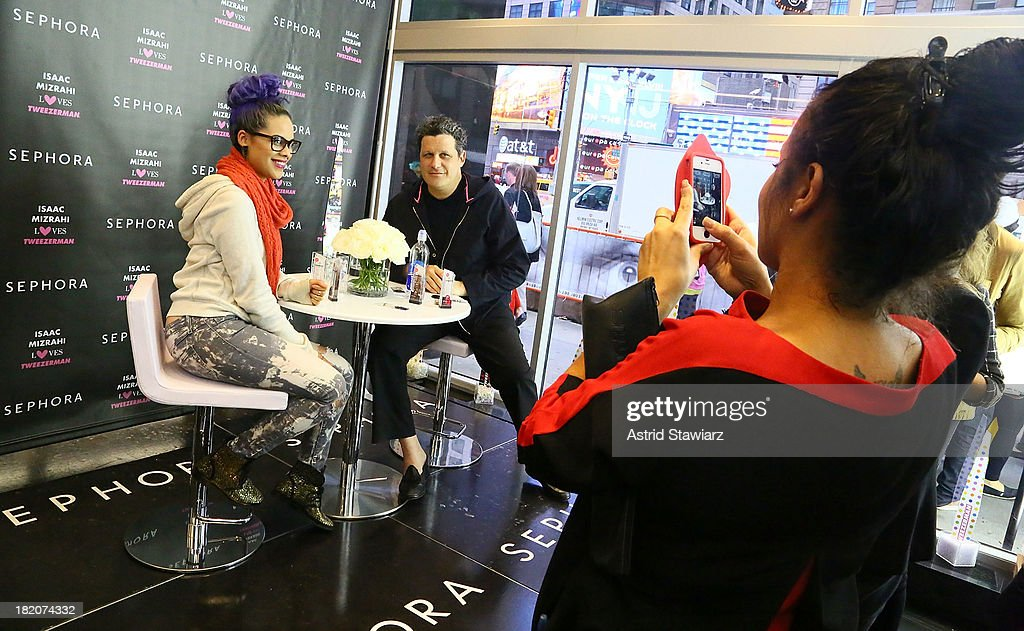 Designer Isaac Mizrahi (right) poses for photos with fans during the Tweezerman & Isaac Mizrahi event at Sephora Times Square on September 27, 2013 in New York City.