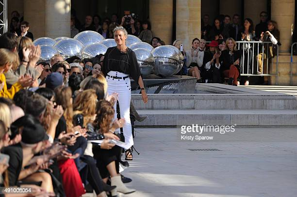 Designer Isabel Marant salutes the audience at the end of her show as part of the Paris Fashion Week Womenswear Spring/Summer 2016 on October 2 2015...