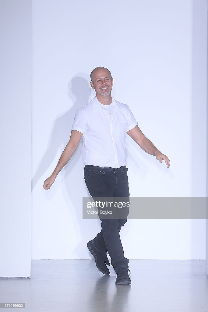 Designer Italo Zucchelli acknowledges the applause of the audience after the Calvin Klein Collection show during Milan Menswear Fashion Week Spring Summer 2014 on June 23, 2013 in Milan, Italy.
